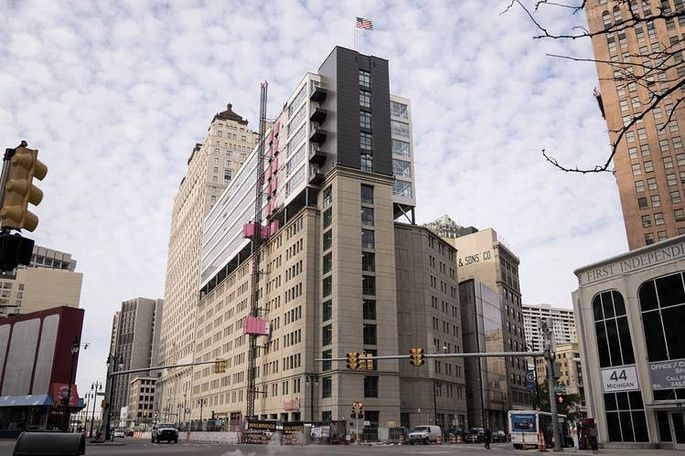 The Griswold, a five-story apartment building, sits on top of a pre-existing, 10-story parking facility.