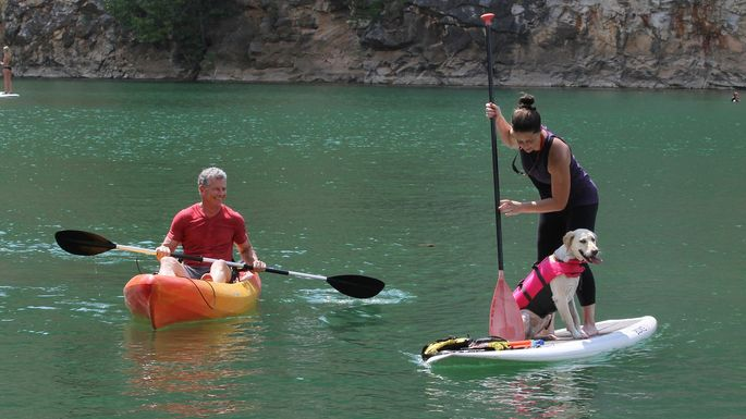 A kayaker and a paddleboarder in Mead's Quarry, part of the Ijams Nature Center in the South Knoxville section of Knoxville, TN.