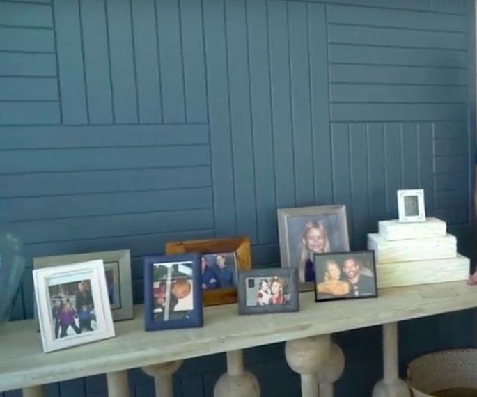 Framed family photos create a warm welcome.