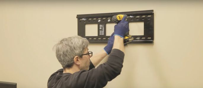 Use a screwdriver or impact drill to tighten the bolts.