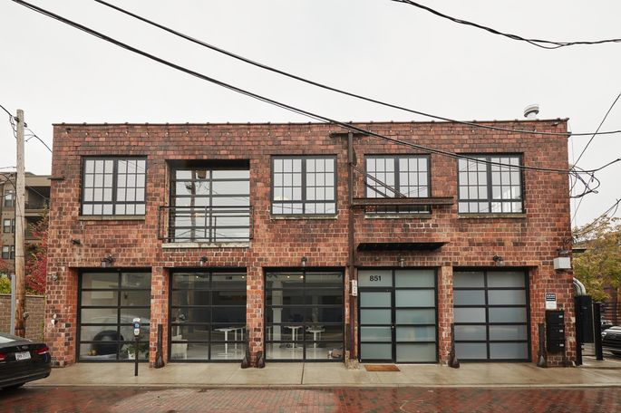 Brady Konya and his husband, Kyle Boettcher, renovated the commercial building to create a 3,000-square-foot home, plus a second-floor rental and commercial space on the first floor. They bought the building for $680,000 in 2008, helped secure a zoning change for the property, then spent nearly $1 million on a renovation.