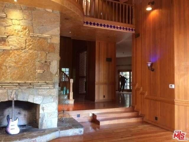 The house today still has a large stone fireplace and wood paneled walls