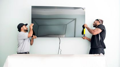 How to Mount a TV on the Wall Without Breaking Your Back (or TV)