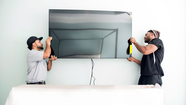 How to Mount a TV on the Wall Without Breaking Your TV | realtor.com®