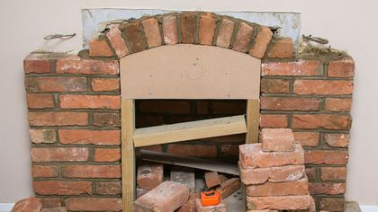 Drop That Sledgehammer! How Removing a Fireplace Could Affect Your Home's Value