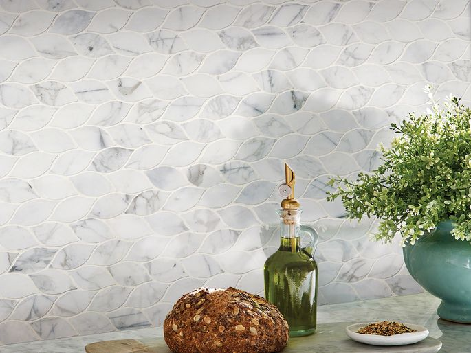 Choose natural stone tile in a bold color or more muted tones.