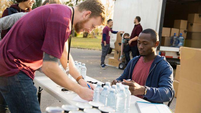 Volunteers collect water.