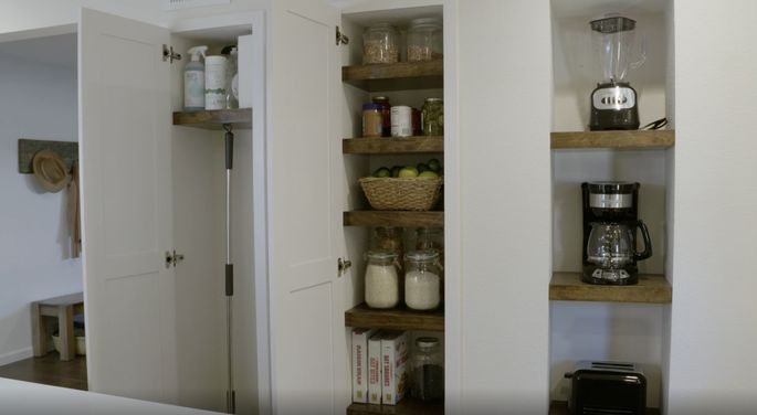 Recessed cabinets save valuable space in this small kitchen.