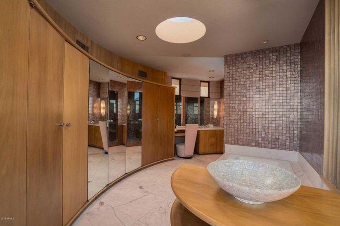 Master bath with unique closet space