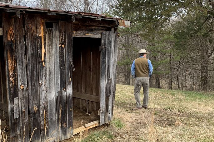 Craig Jacobs looking for wood on an old farm in Virginia.