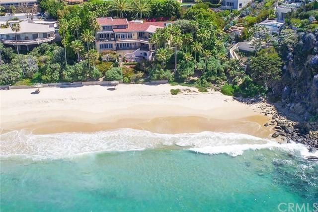 The home has 180 feet of coastal frontage and a private beach.