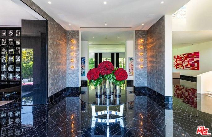 Entry with chevron black-marble floors