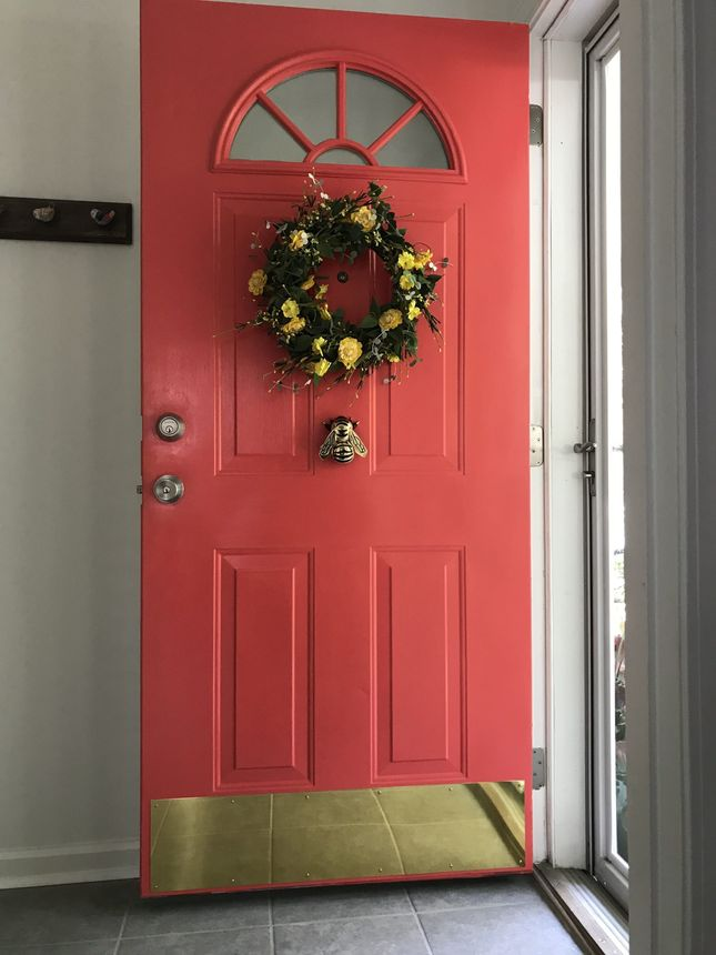 Caban painted her new door red and added the bumblebee knocker.
