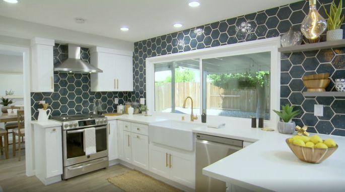 In addition to traditional upper cabinets, Anstead incorporated open shelves in this kitchen renovation.