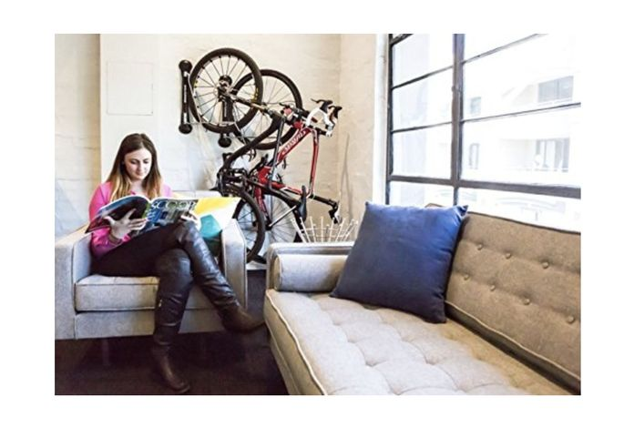 Hang bikes on the wall behind a couch or door.