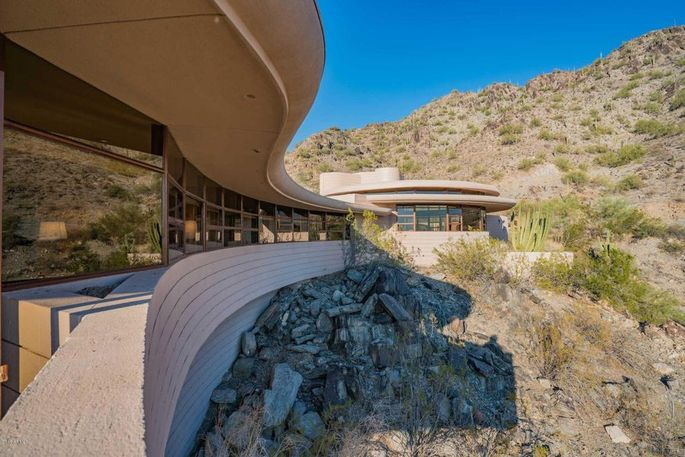 The curvy home is built atop a solid cement brick wall that has never failed.