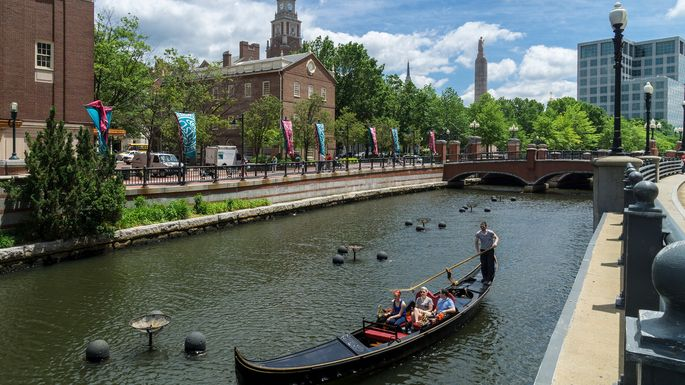 Tourists pass the Rhode Island School of Design as they tour the Providence River from aboard a gondola.