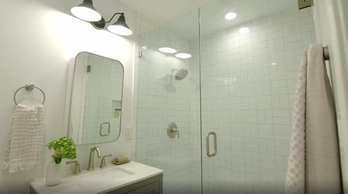 After: A larger shower makes the bathroom feel more spacious.