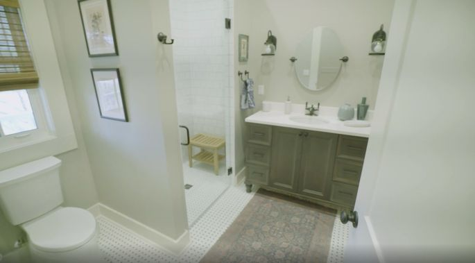 This shower works perfectly in this stylish bathroom.