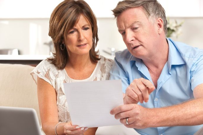 Mature couple worrying about finances