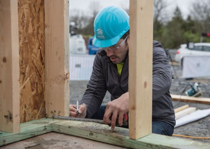 Jonathan measuring a Habitat for Humanity home