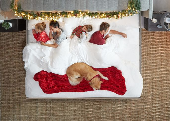 The whole family and a pet can fit in this jumbo-sized bed.