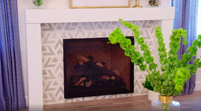 This fireplace's white and gray tile is modern and chic.