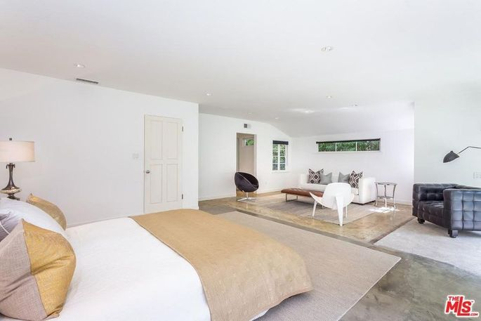 Two bedrooms were combined to make the master bedroom.