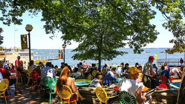 People enjoy the summer on the edge of Lake Mendota