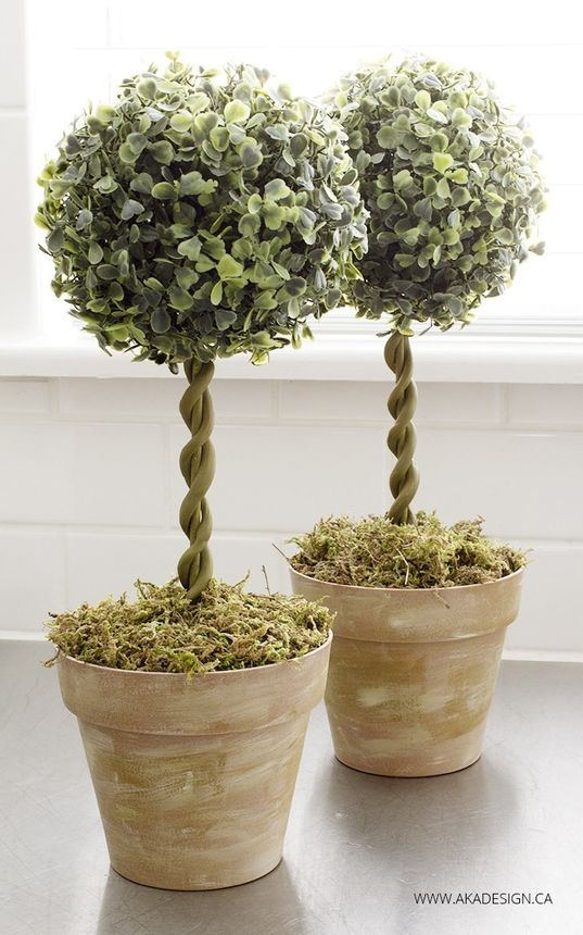 Turn simple dollar store items into realistic topiary trees.