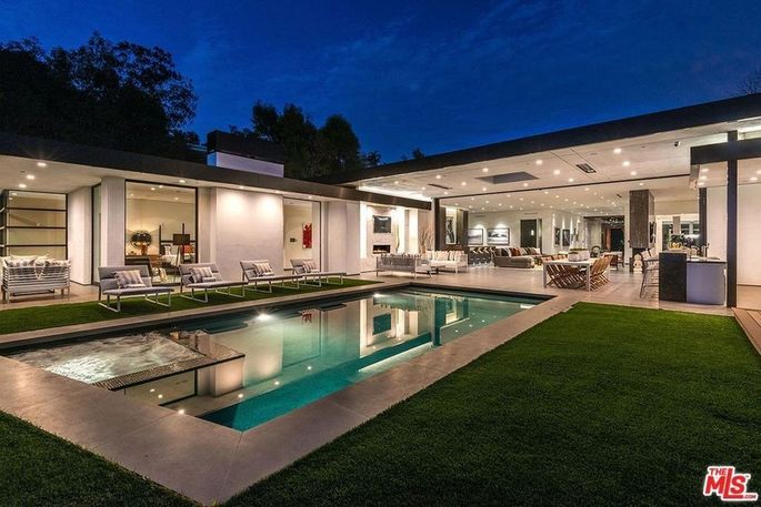Backyard with pool and entertaining space