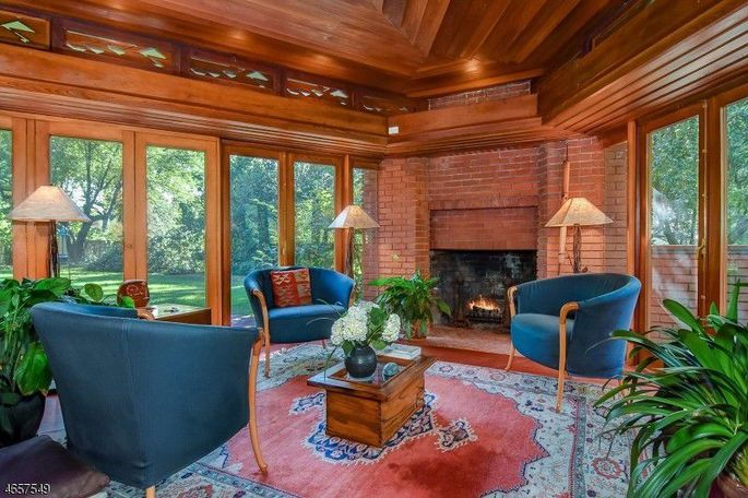 Built in 1915, the home features 14 French doors, allowing natural light to filter through every space.