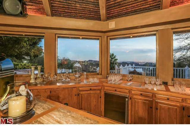 mariah carey and nick cannon looks to cash in on bel air mansion