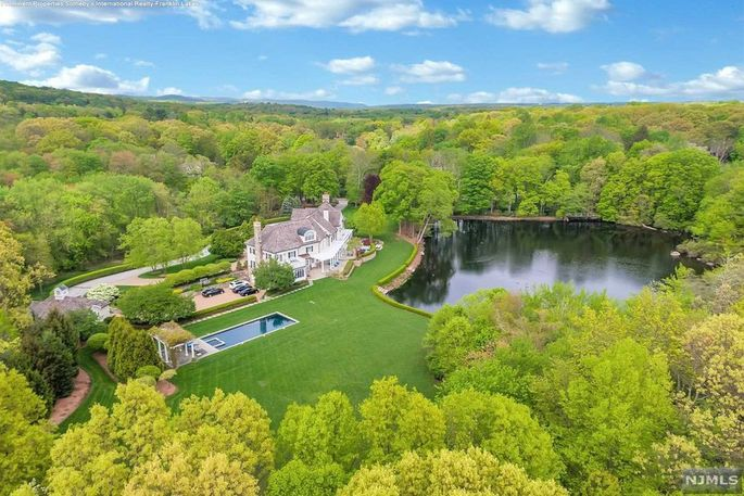 19.5 acres with pool and pond