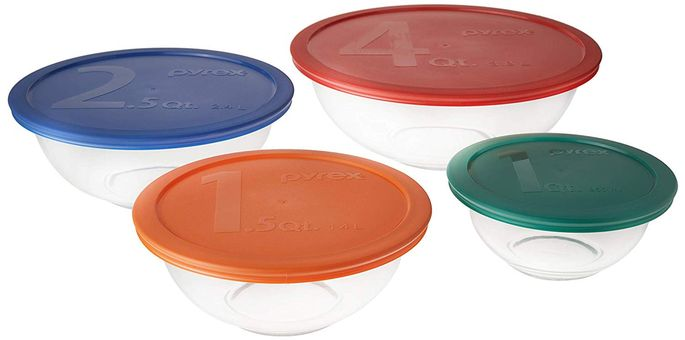 This set includes four glass mixing bowls with green, orange, blue, and red plastic covers.