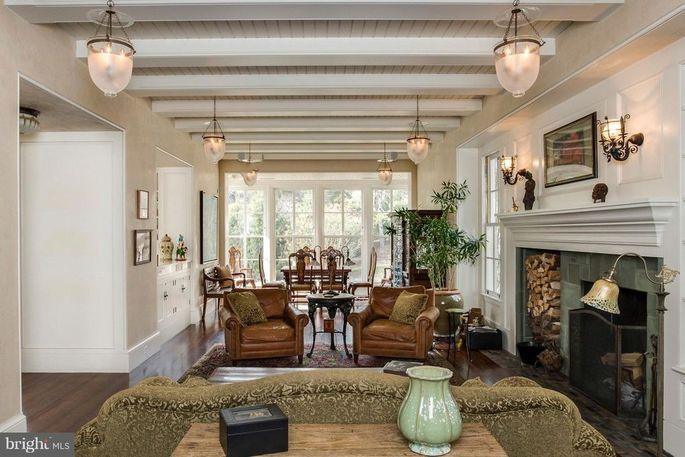Living and dining room with beamed ceiling