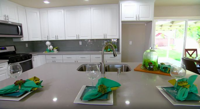 The backsplash and counters almost match, but it all looks good together.