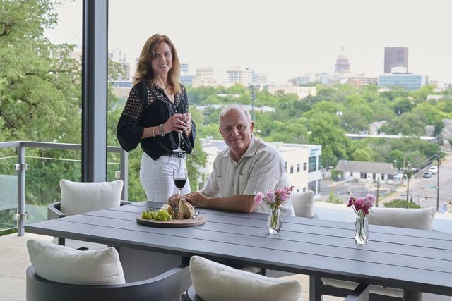 Dan and Sylvia Sharplin in the outdoor living space of their home with its view of the Texas State Capitol.