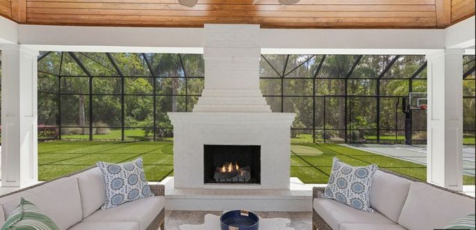 Outdoor fireplace with court in background
