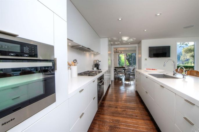 Open kitchen with bar seating