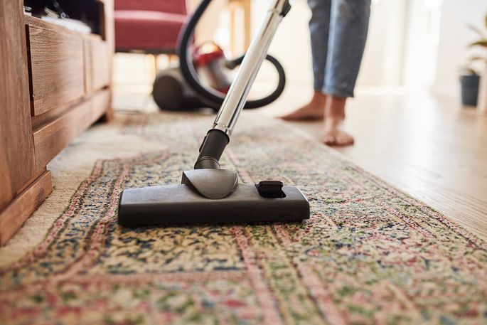 Vacuum thoroughly, including in corners and under furniture if possible, to get rid of spiders.