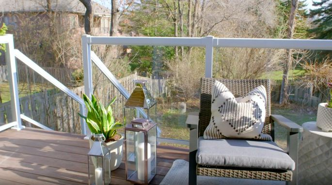 These glass railings provide a great view of the yard.
