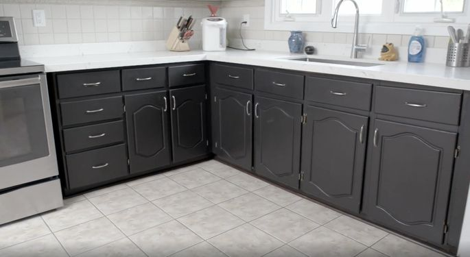 These kitchen cabinets are dark and dated.