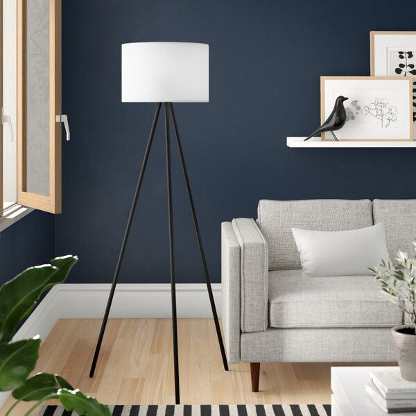 A minimalist floor lamp is a stylish way to add light where you need it.