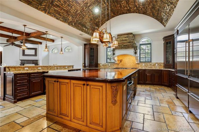 Chef's kitchen with barrel-vaulted ceiling