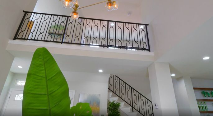 These modern railings are a big upgrade from the white walls that were there before.