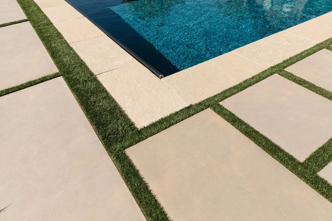 The Ryans used artificial turf between pavers that won't be damaged by the pool's chlorine.