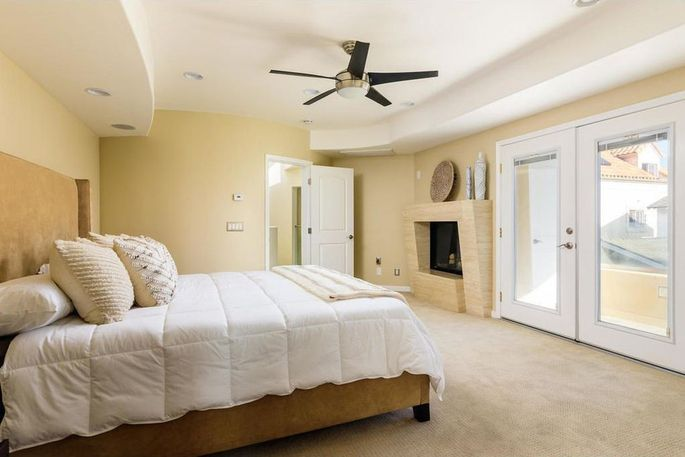 Master suite with fireplace and balcony