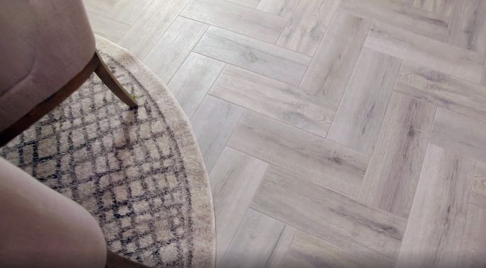 Why settle for a mix of tile and old laminate when you can have beautiful herringbone-patterned flooring?