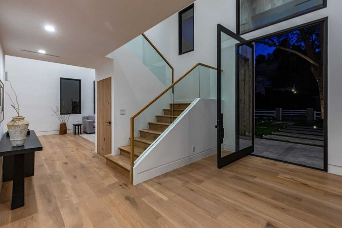 Entry with glass pivot door